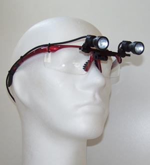 ErgonoptiX-D-Light-Duo-HD-shadowless-surgery-headlight-on-red-frames.jpg